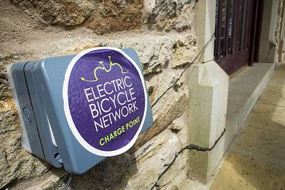 An Electric Bike Recharging Point Art Print