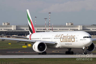 An Emirates Boeing 777 At Milano Art Print by Luca Nicolotti