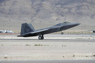 On The Runway Photograph - An F-22 Raptor Landing On The Runway by Remo Guidi