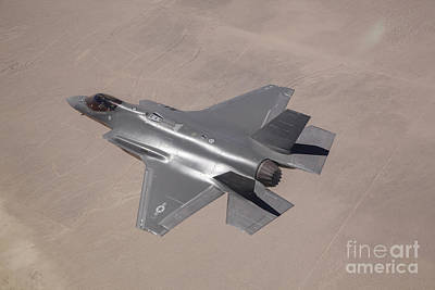 Joint Strike Fighter Photograph - An F-35 Lightning II Flies Over Edwards by Stocktrek Images