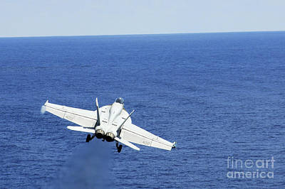 An Fa-18e Hornet Taking Off From Uss Print by Stocktrek Images