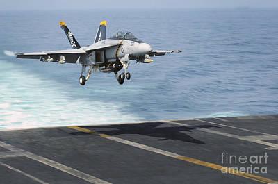 An Fa-18f Super Hornet Prepares To Land Art Print by Stocktrek Images
