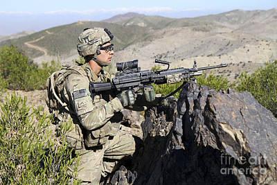 Infantryman Photograph - An Infantryman Provides Overwatch by Stocktrek Images