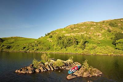 Inflatable Boats Photograph - An Inflatable Kayak On Ullswater by Ashley Cooper