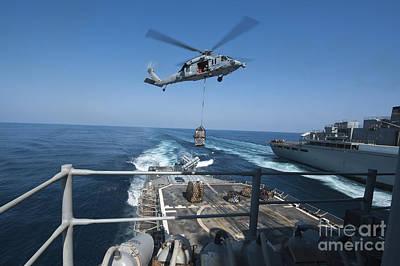 An Mh-60s Sea Hawk Brings Pallets Art Print by Stocktrek Images