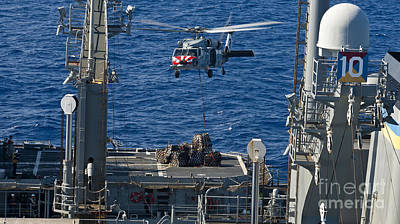 An Mh-60s Sea Hawk Delivers Supplies Art Print by Stocktrek Images