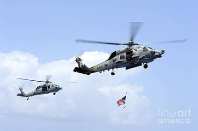 Rotary Wing Aircraft Photograph - An Mh-60s Sea Hawk Helicopter Follows by Stocktrek Images