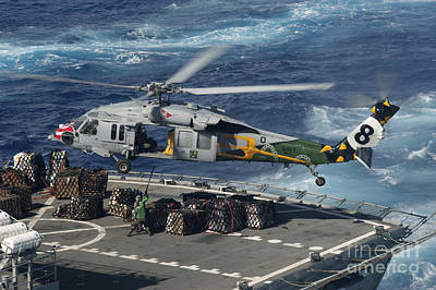 An Mh-60s Sea Hawk Helicopter Picks Art Print by Stocktrek Images