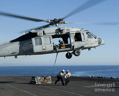 An Mh-60s Sea Hawk Helicopter Prepares Print by Stocktrek Images