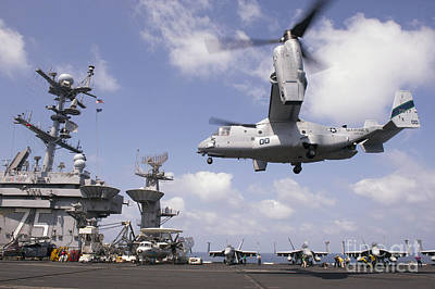 Transportation Royalty-Free and Rights-Managed Images - An Mv-22 Osprey Lands Aboard Uss Harry by Stocktrek Images