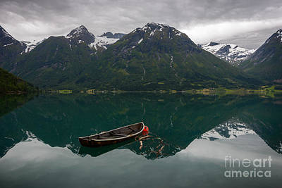 Photograph - An Old Boat And Some Mountains With Reflection In The Water by IPics Photography