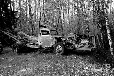 Birds Rights Managed Images - An Old Logging Boom Truck In Black And White Royalty-Free Image by Jeff Swan