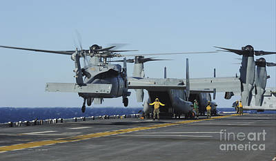 Aromatherapy Oils Royalty Free Images - An Sh-60 Sea Hawk Lands On The Flight Royalty-Free Image by Stocktrek Images