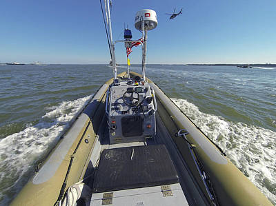 Inflatable Photograph - An Unmanned Rigid-hull Inflatable Boat by Stocktrek Images