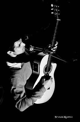 Photograph - An Unreachable Guitarist by Stwayne Keubrick