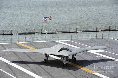 Uca Photograph - An X-47b Unmanned Combat Air System by Stocktrek Images
