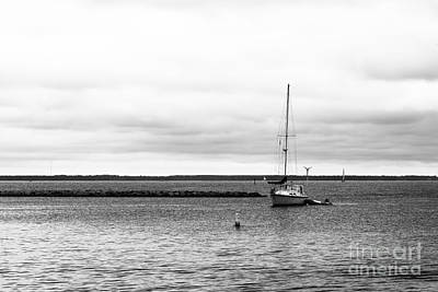 Water Suppliers Photograph - Anchored Sailboat by Robert Yaeger