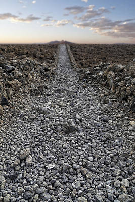 Ancient Rocky Road Leading To The Horizon. Art Print by Edward Fielding