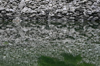 Photograph - Ancient  Stone Wall  Reflection On Water by Phoenix De Vries