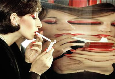 Photograph - Anjelica Huston Lighting A Cigarette by Bob Stone