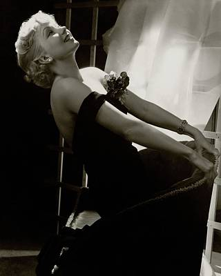 Photograph - Ann Sothern Kneeling On An Armchair by Lusha Nelson