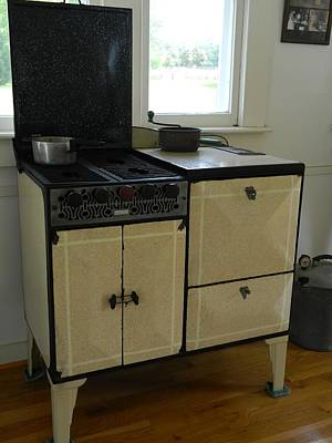 Photograph - Antique Enameled Stove by George Pedro
