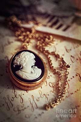 Photograph - Antique Gold Cameo Laying On A Letter And Photos by Sandra Cunningham