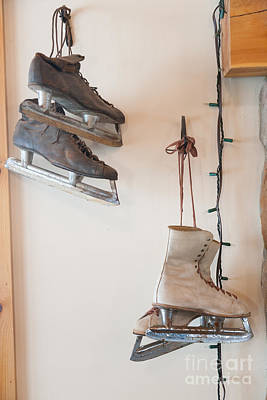 Photograph - Antique Ice Skates Hanging On A Wall. by Don Landwehrle