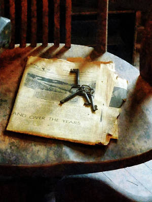 Art Print featuring the photograph Antique Keys On Newspaper by Susan Savad