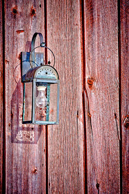 Antique Lantern On Weathered Red Barn Art Print by Jeff Sinon
