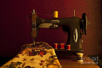 Photograph - Antique Sewing Machine With Spools And Thread And Fabric by Jim Corwin