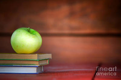 Apple On Pile Of Books Art Print by Michal Bednarek