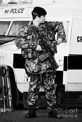 Armed British Soldier At Psni Landrover On Crumlin Road At Ardoyne Shops Belfast 12th July Art Print by Joe Fox