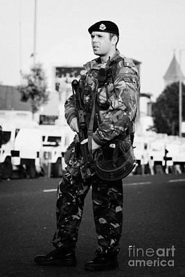 Armed British Soldier On Crumlin Road At Ardoyne Shops Belfast 12th July Art Print by Joe Fox