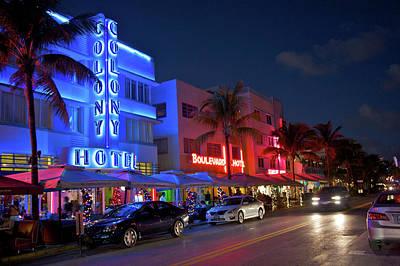 Photograph - Art Deco Illuminated Buildings At Night by Barry Winiker
