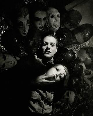 Photograph - Artist Oliver Messel Surrounded By Various Masks by George Hoyningen-Huene