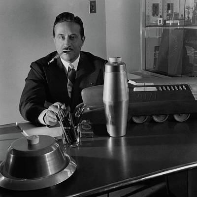 Artist Raymond Loewy Sitting At His Desk Art Print by Luis Lemus