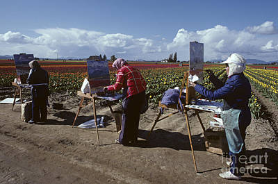 Artists Painting Tulip Fields Standing In A Row  Art Print by Jim Corwin