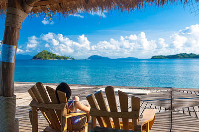 Michael Jackson - Asian young lady relaxing on a wooden chair looking at the beautiful sea and cloud by Jirawat Cheepsumol