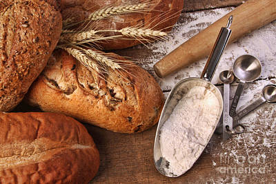 Photograph - Assortment Of Loaves Of Bread With Flour by Sandra Cunningham