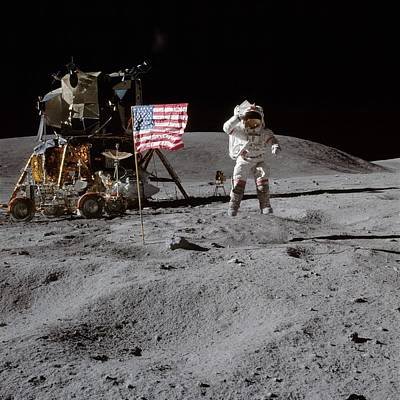 Glister Photograph - Astronaut Saluting The American Flag During Apollo 16 Mission by Celestial Images