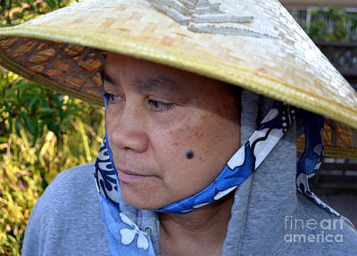 Facial Photograph - Attractive Filipina Woman With A Mole On Her Cheek And Wearing A Conical Hat by Jim Fitzpatrick