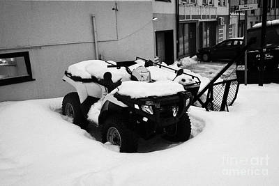 atv quad covered in snow Honningsvag finnmark norway europe Art Print by Joe Fox