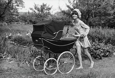 Photograph - Audrey Hepburn Pushing A Pram by Henry Clarke