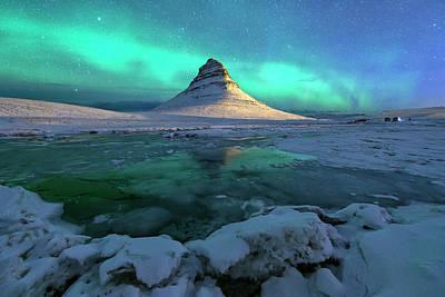 Photograph - Aurora Over Kirkjufell Mountain Iceland by Ratnakorn Piyasirisorost
