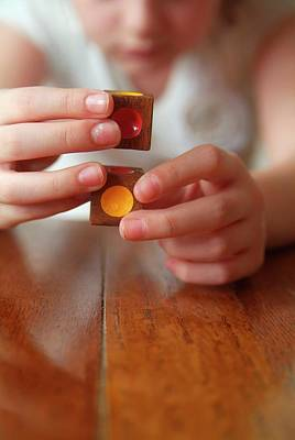 Human Condition Photograph - Autistic Girl Playing With Toy Blocks by Hannah Gal