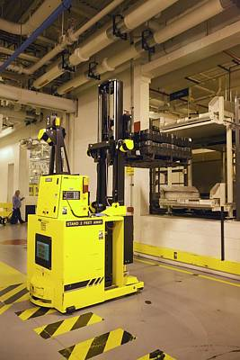 Factory Photograph - Automated Forklift At A Car Factory by Jim West
