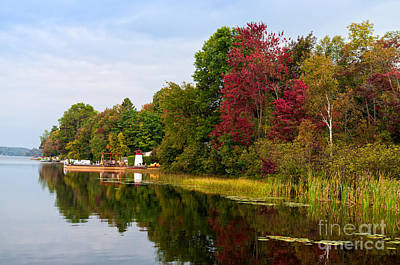Photograph - Autumn Lake Scene With A Toy Lighthouse And Colorful Trees by Les Palenik