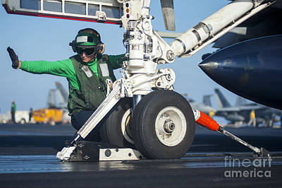 Transportation Royalty-Free and Rights-Managed Images - Aviation Boatswains Mate Attaches An by Stocktrek Images