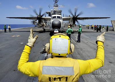 Greyhound Photograph - Aviation Boatswains Mate Directs A C-2a by Stocktrek Images